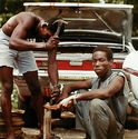 Men Fixing Car from Tobago, West Indies by Carol Fisher