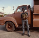 Boy and Brown Truck from Tobago, West Indies by Carol Fisher